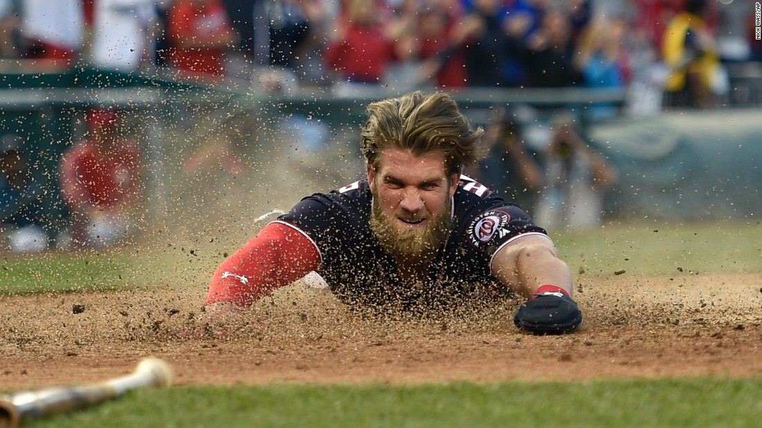 Washington's Bryce Harper slides home to score the winning run on a hit by Daniel Murphy during a game against Philadelphia on Friday, April 14. Washington won 3-2.