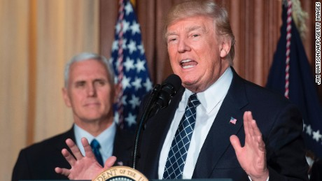 "US President Donald Trump (C) speaks before signing the Energy Independence Executive Order at the Environmental Protection Agency (EPA) Headquarters in Washington, DC, March 28, 2017, with Vice President Mike Pence (L). President Donald Trump claimed an end to the ""war on coal"" Tuesday, as he moved to roll back climate protections enacted by predecessor Barack Obama. / AFP PHOTO / JIM WATSON        (Photo credit should read JIM WATSON/AFP/Getty Images)"