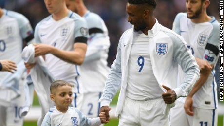 Defoe and Lowery line up prior to England's World Cup qualifier against Lithuania.