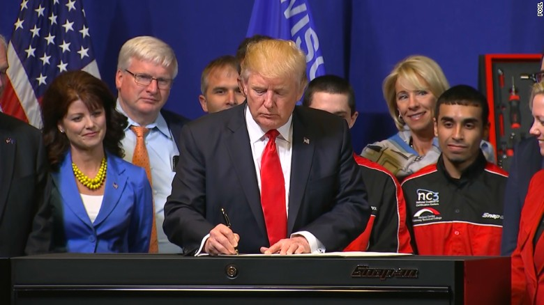 Trump signs executive order in Wisconsin