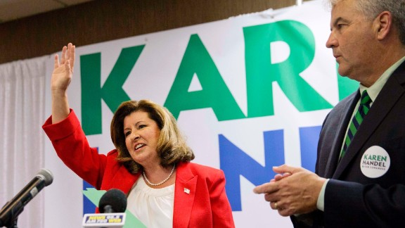 Republican candidate for Georgia's Sixth Congressional seat Karen Handel waves after speaking at an election night watch party with husband Steve, right, in Roswell, Ga., Tuesday, April 18, 2017. Republicans are bidding to prevent a major upset in a conservative Georgia congressional district Tuesday where Democrats stoked by opposition to President Donald Trump have rallied behind a candidate who has raised a shocking amount of money for a special election. (AP Photo/David Goldman)