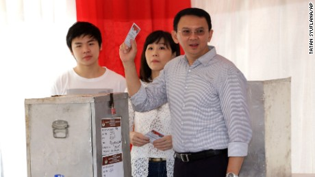 Jakarta governor concedes election after divisive campaign