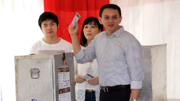 "Jakarta Governor Basuki ""Ahok"" Tjahaja Purnama who is seeking for his second term in office, his wife Veronica and son Nicholas, left, cast their ballot at a polling station during the runoff election in Jakarta, Indonesia, Wednesday, April 19, 2017. Residents of the Indonesian capital are electing a governor after a polarizing campaign that undermined Indonesia"