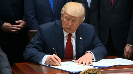 Trump signs health care bill for veterans
