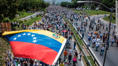 Thousands rally Wednesday against Venezuelan President Nicolas Maduro in eastern Caracas.