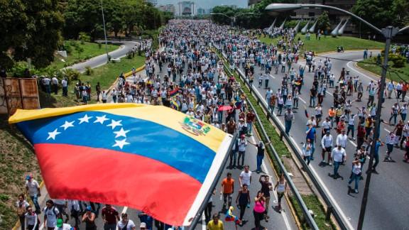 Thousands of people rally against Venezuelan President Nicolas Maduro along the Francisco Fajardo highway in eastern Caracas.