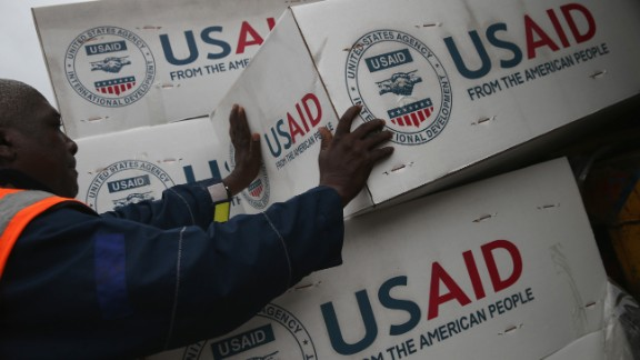 HARBEL, LIBERIA - AUGUST 24:  Workers unload medical supplies to fight the Ebola epidemic from a USAID cargo flight on August 24, 2014 in Harbel, Liberia. The U.S. government sent more than 16 tons of supplies, including anti-contamination clothing (PPE), plasting sheeting and water purification machinery. International aid agencies and the Liberian government are struggling to keep up with the rapidly-expanding epidemic. The deadly virus has killed at least 1,400 people in West Africa and more in Liberia than any other country.  (Photo by John Moore/Getty Images)