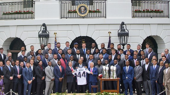 President Barack Obama holds a New England Patriots team football jersey, flanked by New England Patriots coach Bill Belichick, left, and team owner Robert Kraft, during a ceremony on the South Lawn of the White House in Washington, Thursday, April 23, 2015.