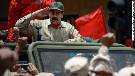 Venezuelan President Nicolas Maduro salutes Monday during Bolivarian militia celebrations in Caracas.