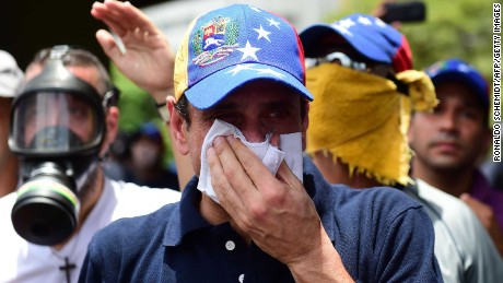 Opposition leader Henrique Capriles suffers the effects of tear gas during a Wednesday rally in Caracas.