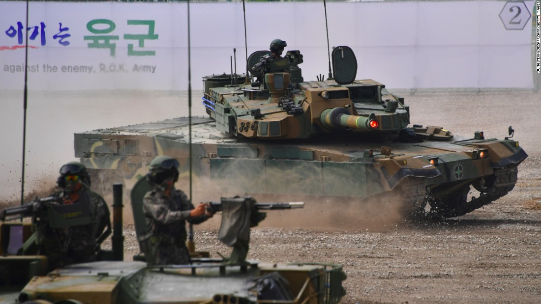 "<strong>A South Korean K2 tank (C) moves during an equipment demonstration at the Defense Expo Korea 2016 at KINTEX exhibition hall in Goyang, north of Seoul, on September 10, 2016. The K2, nicknamed the ""Black Panther"" is considered to be among the world's best tanks.</strong>"