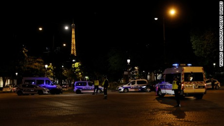 Police officers block the access to the Champs Elysees in Paris after a shooting on April 20, 2017. One police officer was killed and another wounded today in a shooting on Paris's Champs Elysees, police said just days ahead of France's presidential election. France's interior ministry said the attacker was killed in the incident on the world famous boulevard that is popular with tourists.  / AFP PHOTO / THOMAS SAMSON        (Photo credit should read THOMAS SAMSON/AFP/Getty Images)