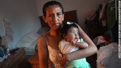 AURORA, CO - MAY 30:  Undocumented Mexican immigrant Jeanette Vizguerra holds her three month old daughter Zury in her family apartment on May 30, 2011 in Aurora, Colorado. Vizguerra, a mother of three American children, is facing a deportation hearing July 13 at Denver's Federal Courthouse. Just one of millions of undocumented immigrants living in the United States, Vizguerra first came to Colorado from Mexico City with her husband 14 years before. Now a community activist for immigration rights and a small business owner of a janitorial service, she was stopped by a traffic policemen for driving with expired tags and was taken to jail when she could not prove she was in the country legally. She has been out on bail for two years during lengthy court proceedings, but now faces the real possibility that she will be deported back to Mexico and separated from her family in the United States. (Photo by John Moore/Getty Images)