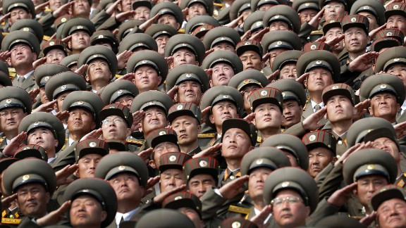 North Korean soldiers salute while the national anthem is played during a military parade on Saturday, April 15, 2017, in Pyongyang, North Korea to celebrate the 105th birth anniversary of Kim Il Sung, the country's late founder and grandfather of current ruler Kim Jong Un. (AP Photo/Wong Maye-E)
