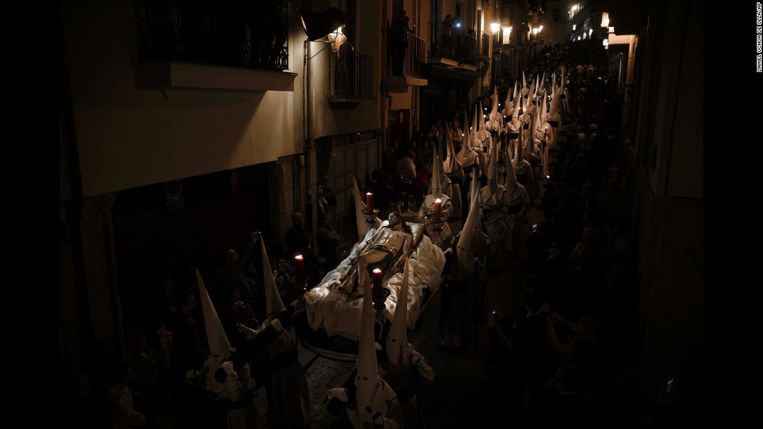 "Penitents from the ""Hermandad Penitencial de Jesus Yacente"" brotherhood take part in a procession in Zamora, Spain, during the early hours of Friday, April 14. Hundreds of processions took place throughout the country during the Easter Holy Week."
