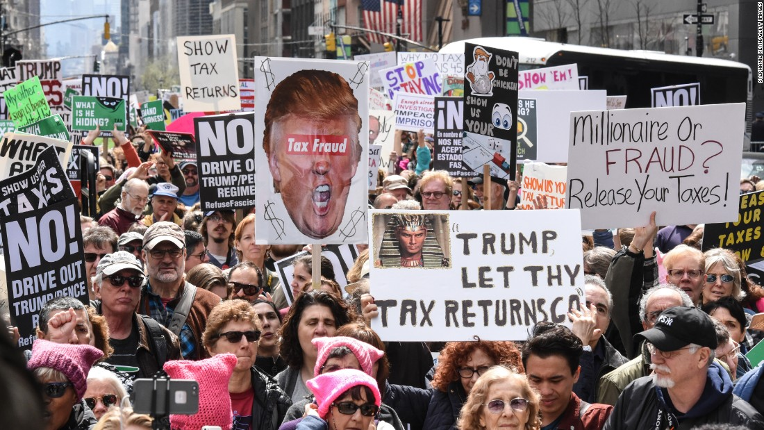 "People participate in a Tax Day protest in New York on April 15, calling on US President Donald Trump to release his <a href=""http://www.cnn.com/2017/04/18/politics/trump-tax-day-returns/index.html"" target=""_blank"">tax returns</a>."