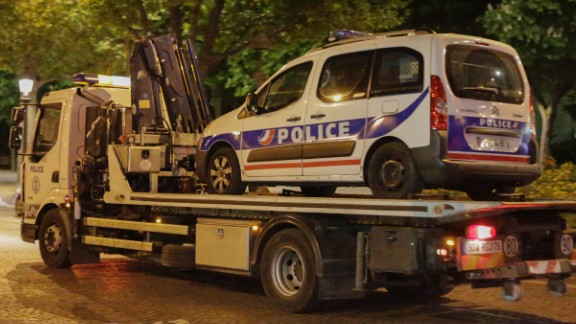 A police van is towed away from the scene.