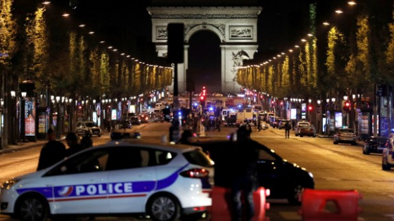 TOPSHOT - Police officers block the access to the Champs Elysees in Paris after a shooting on April 20, 2017.One police officer was killed and another wounded today in a shooting on Paris's Champs Elysees, police said just days ahead of France's presidential election. France's interior ministry said the attacker was killed in the incident on the world famous boulevard that is popular with tourists. / AFP PHOTO / THOMAS SAMSON        (Photo credit should read THOMAS SAMSON/AFP/Getty Images)
