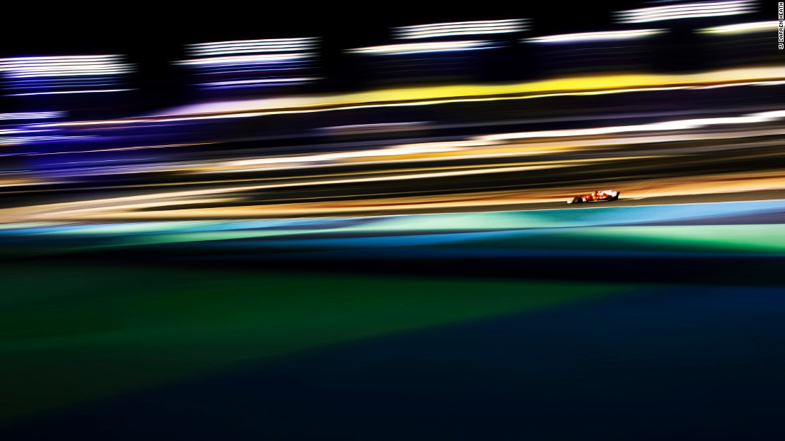 """You've got night time all around with with beautiful racing cars thrashing around and people like me trying to make them look as attractive as possible.""<br />© Darren Heath<br />"