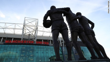 "Manchester United tweeted its condolences accompanied by a photo of the iconic ""Holy Trinity"" statue in front of Old Trafford."