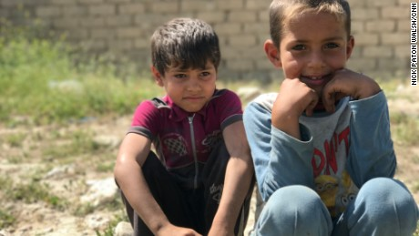 Children who fled the fighting in western Mosul waiting at a collection point for displaced families.