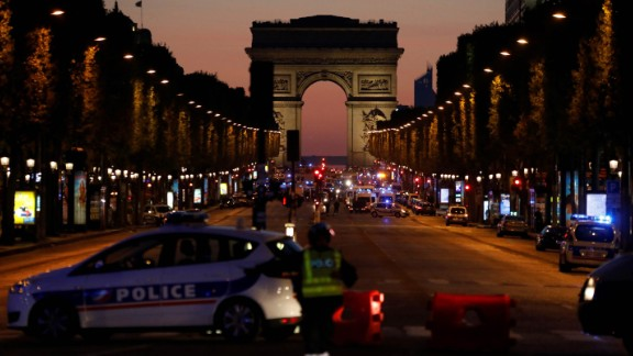 Police officers block access to the Champs-Elysées in Paris after a shooting on Thursday, April 20. One police officer and an attacker were killed, according to CNN affiliate BFMTV and the French Interior Ministry.