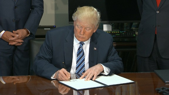 President Donald Trump signs financial reform executive orders 0421
