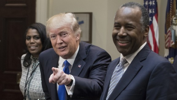 """Trump met with several African-American leaders for a listening session to kick off Black History Month on Wednesday, February 1. Trump was seated between Ben Carson, his nominee to head the Department of Housing and Urban Development, and Omarosa Manigault, a former """"Apprentice"""" contestant who is now part of the administration."""