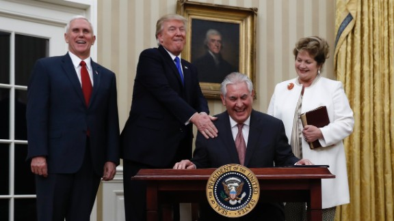 Trump puts his hand on the shoulder of Secretary of State Rex Tillerson after Tillerson was sworn in on February 1. They are joined by Vice President Pence and Tillerson's wife, Renda St. Clair. Tillerson, a former CEO of ExxonMobil, was confirmed in the Senate by a vote of 56 to 43.