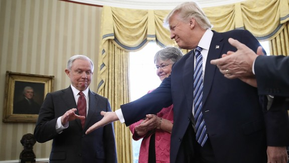 Trump offers his hand to Jeff Sessions, who had just been sworn in as the new attorney general on February 9. Sessions, one of Trump's closest advisers and his earliest supporter in the US Senate, was confirmed by a 52-47 vote that was mostly along party lines. He was accompanied to the swearing-in by his wife, Mary.