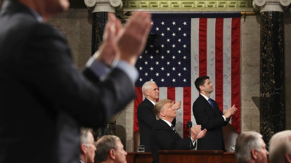 """Trump applauds Carryn Owens during his speech to a joint session of Congress on Tuesday, February 28. Owens' husband, Navy SEAL William """"Ryan"""" Owens, was killed during a recent mission in Yemen. """"Ryan died as he lived: a warrior and a hero, battling against terrorism and securing our nation,"""" Trump said. The applause in the chamber lasted over a minute, which Trump said must be a record."""