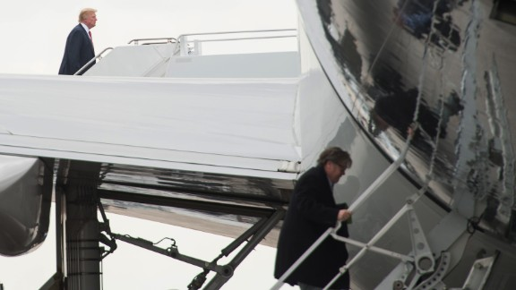 """Trump, left, and chief strategist Steve Bannon board Air Force One before returning to Washington on Sunday, March 5. Bannon, one of Trump's earliest cheerleaders in his role leading the ultra-conservative website Breitbart News, joined the Trump campaign in August 2016. According to CNN's Chris Cillizza, he was widely credited with putting skin and muscle on the bare bones of Trump's """"America First"""" worldview."""