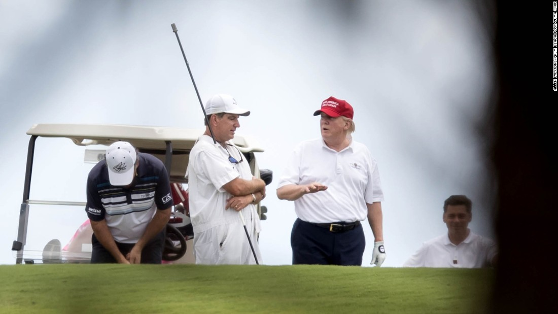 "Trump talks to a caddie during a round of golf in West Palm Beach, Florida, on Saturday, April 8. Trump frequently criticized President Obama for playing golf, <a href=""http://www.cnn.com/2017/03/19/politics/trump-golf-weekends/"" target=""_blank"">but he has been a frequent golfer</a> during his first few months in office."