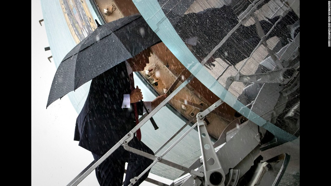 In pouring rain, the President boards Air Force One for a trip to Florida, where he would meet with Chinese President Xi Jinping on Thursday, April 6.