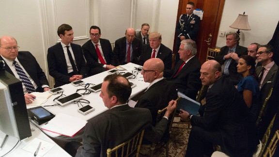In this image provided by the White House, Trump is briefed by his national security team about the missile strike in Syria on April 6. They were at a secured location on Trump's Mar-a-Lago resort.