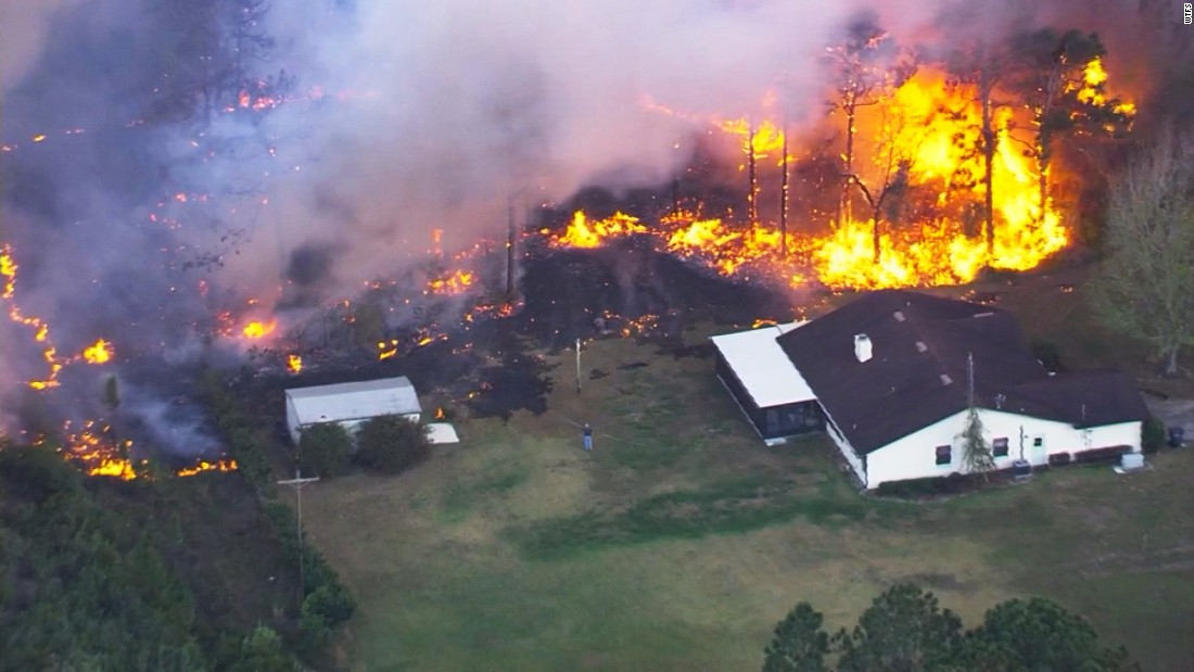 "A massive wildfire burns in Polk County, Florida, on Friday, April 21. <a href=""http://www.cnn.com/2017/04/22/us/florida-wildfires-evacuations/"" target=""_blank"">The fire</a> is the latest in ""a series of suspicious fires here in the last two or three weeks,"" Polk County Sheriff Grady Judd told reporters."
