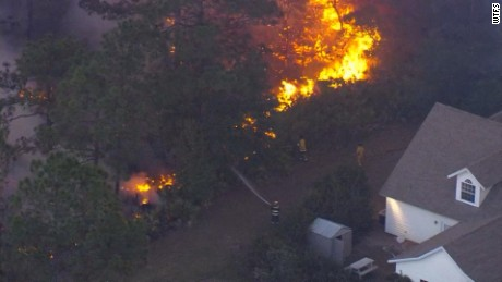 An aerial view shows another wildfire in Polk County.
