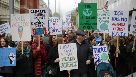 Scientists and science enthusiasts gather prior to the start of the March for Science in central London.