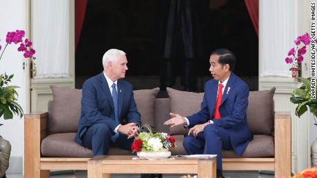 US Vice President Mike Pence (L) listens to Indonesian President Joko Widodo at Merdeka Palace in Jakarta on April 20.