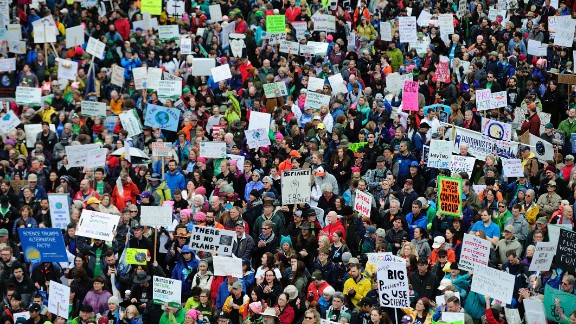 Thousands of protesters fill Tom McCall Waterfront Park during the March for Science in Portland, Oregon, on Saturday, April 22. Protests were held in cities around the world against President Donald Trump