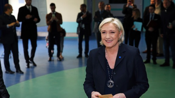 French far-right Front National party's President Marine Le Pen is waiting before she votes in the first round of 2017 French presidential election at a polling station on April 23 in Henin-Beaumont, northern France.
