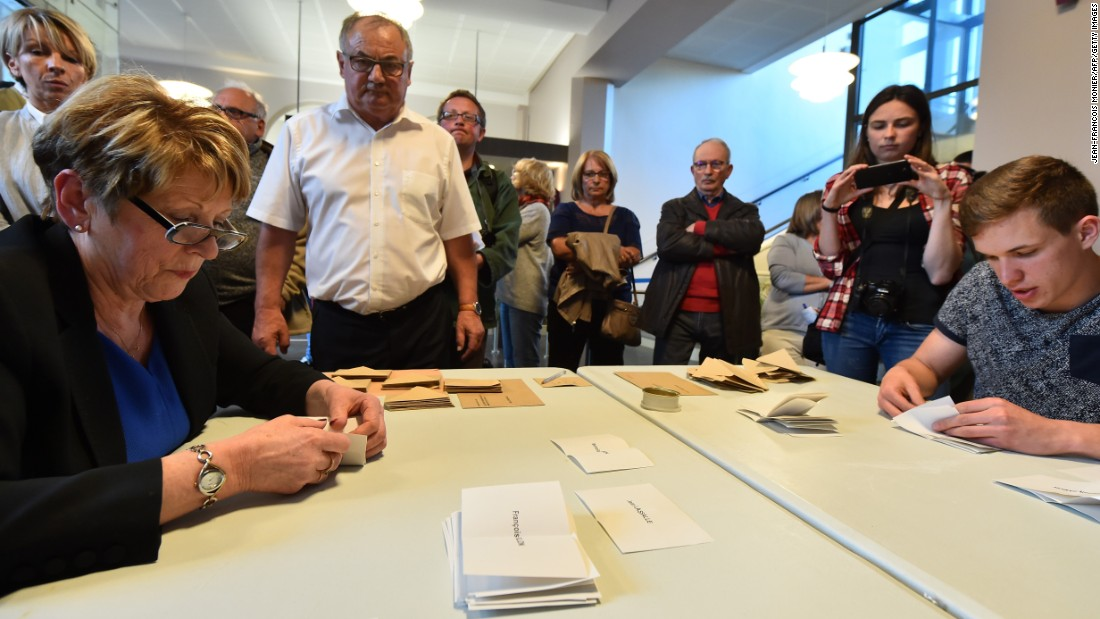 Scrutineers count votes at the end of the first round in Sable-sur-Sarthe.