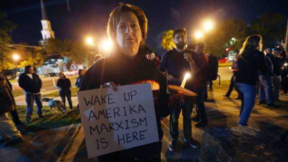 Dana Farley of New Orleans participates in a candlelight vigil at the statue of Jefferson Davis in New Orleans on Monday, April 24, 2017.