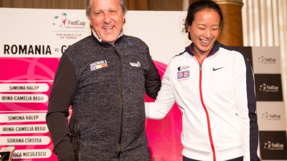 Ilie Nastase and Anne Keothavong posing for photos at the start of theFed Cup tie between Great Britain and Romania.