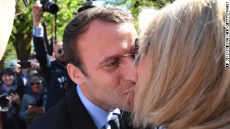 Macron kisses his wife during a campaign visit in Bagneres-de-Bigorre on April 12.