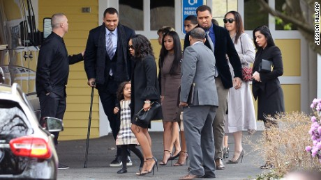 Shayanna Jenkins Hernandez, front, fiancee of former New England Patriots tight end Aaron Hernandez, arrives with their daughter Avielle Janelle Hernandez, Pittsburgh Steeler Center Maurkice Pouncey and his twin brother Mike, and others for a private service for Aaron Hernandez at O'Brien Funeral Home, Monday, April 24, 2017, in Bristol, Conn. The former New England Patriots tight end was found hanged in his cell in a maximum-security prison in Massachusetts on Wednesday. (AP Photo/Jessica Hill)