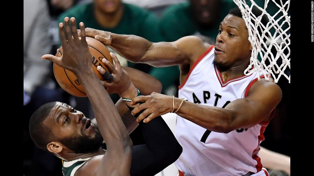 Toronto guard Kyle Lowry fouls Milwaukee center Greg Monroe during an NBA playoff game on Tuesday, April 18.