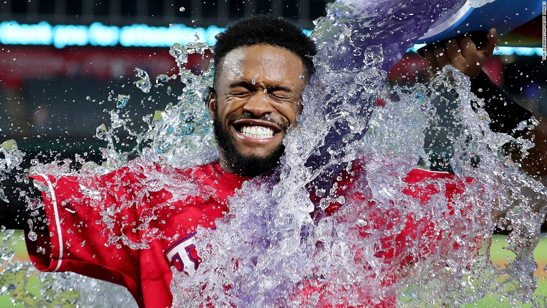 Delino DeShields Jr. is doused by his Texas teammates after hitting the game-winning single against Kansas City on Thursday, April 20. The hit came in the bottom of the 13th inning.