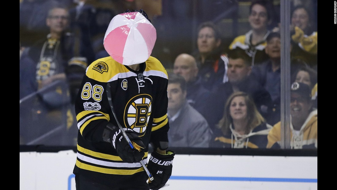 Boston forward David Pastrnak juggles a beach ball that landed on the ice during an NHL playoff game against Ottawa on Wednesday, April 19.