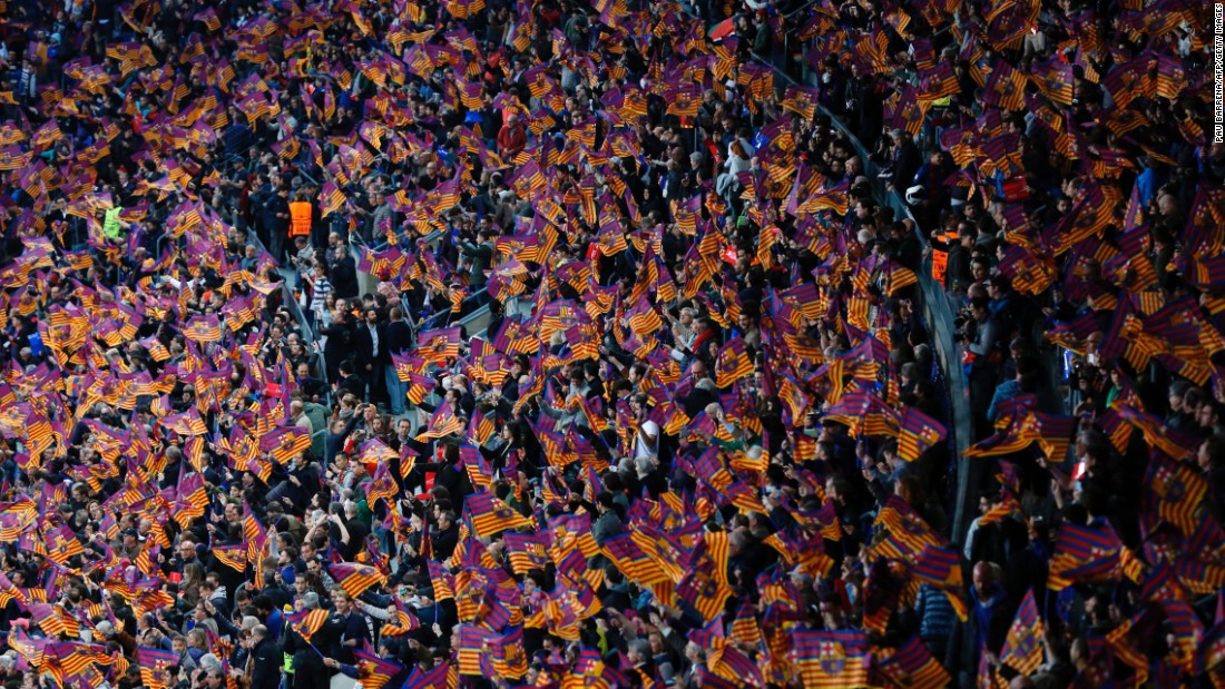 Supporters of FC Barcelona wave flags before their Champions League quarterfinal match against Juventus on Wednesday, April 19.